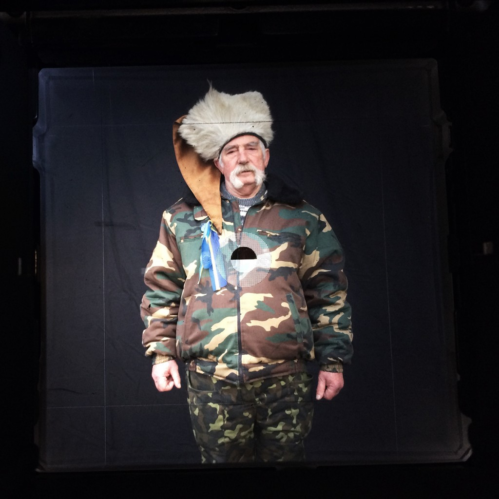 """By mounting an iPhone over her viewfinder, Taylor-Lind was able to share the moments before and after photographing Talas, above, for """"Maidan: Portraits from the Black Square"""" Anastasia Taylor-Lind"""
